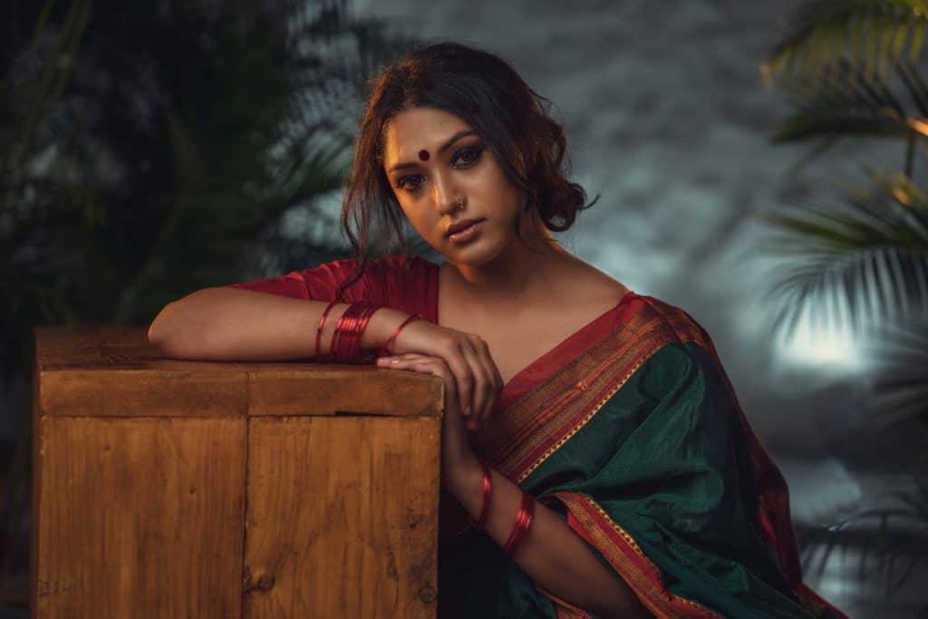 photo-of-woman-in-green-saree-dress-leaning-on-wooden-block-2588992 – Copy